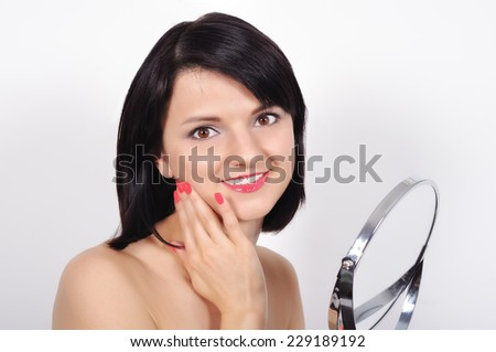 beautiful woman with mirror on a white background - stock photo