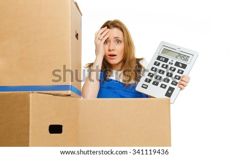 beautiful woman with moving boxes and big calculator  - stock photo