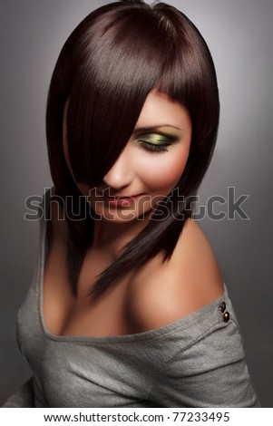 Beautiful woman with nice hair  on dark background