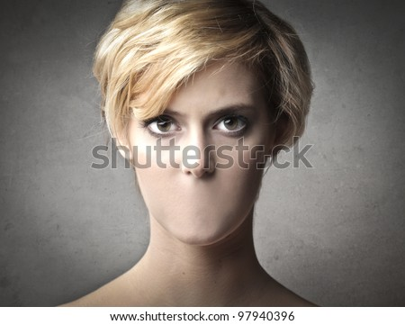 Beautiful woman with no mouth - stock photo