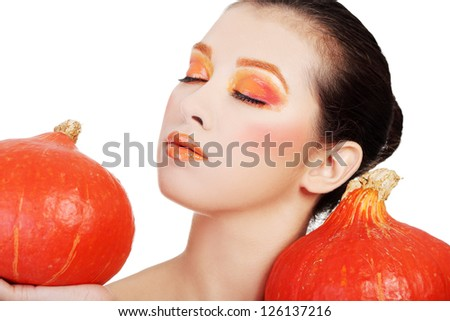 Beautiful woman with orange make up holding pumpkin. Isolated on white - stock photo