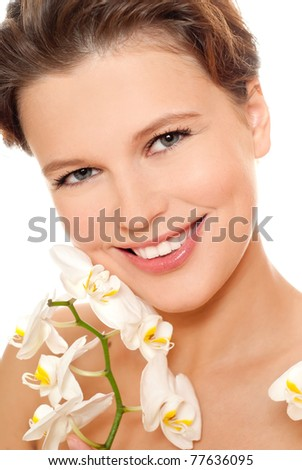 Beautiful woman with orchid flower