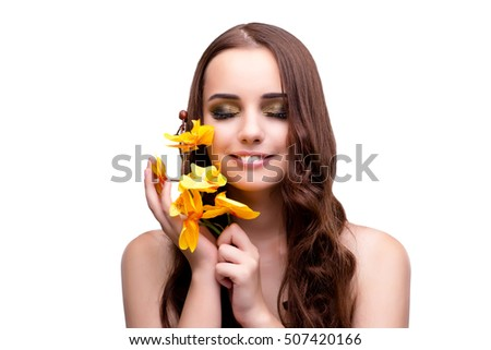Beautiful woman with orchid flower isolated on white