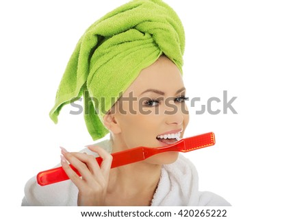 Beautiful woman with oversized toothbrush. - stock photo