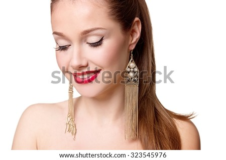 Beautiful woman with pearl earrings. Sexy caucasian young woman model with glamour red lips make-up, eye arrow makeup, purity complexion. Perfect clean skin. Retro beauty style - stock photo