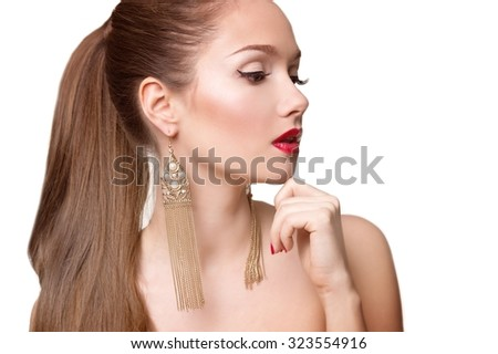Beautiful woman with pearl earrings. Sexy caucasian young woman model with glamour red lips make-up, eye arrow makeup, purity complexion. Perfect clean skin.  - stock photo