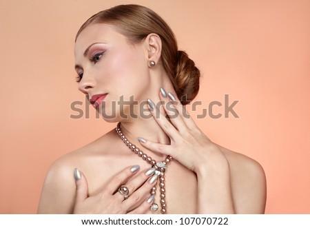 beautiful woman with pearl jewellery - stock photo
