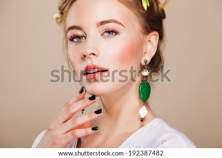 beautiful woman with perfect makeup wearing jewelry - stock photo