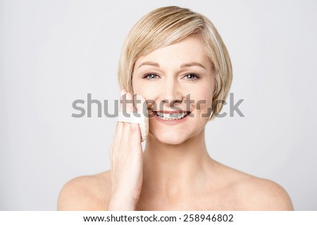 Beautiful woman with perfect skin apply cosmetic sponge - stock photo
