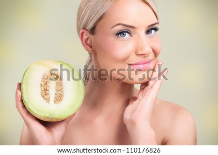 beautiful woman with perfect skin,  melons for perfect complexion, - stock photo