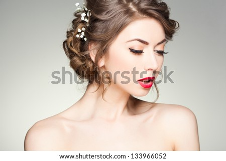 beautiful woman with perfect skin wearing natural make-up and hairstyle - stock photo