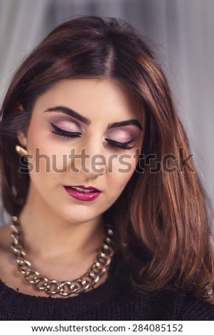 Beautiful woman with professional make up - stock photo