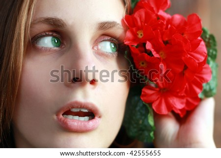 Beautiful woman with red flower - stock photo