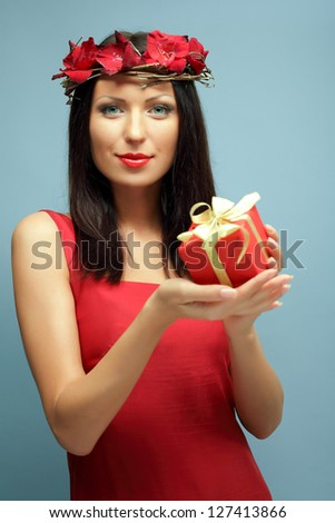 Beautiful woman with red gift, fashion and passion - stock photo