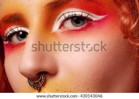 Beautiful Woman with Red Hair and bright makeup. High fashion look, close up beauty portrait model with bright makeup with perfect clean skin . High key. nose piercing. creative make-up - stock photo
