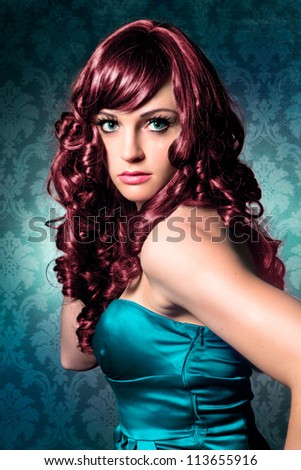 beautiful woman with red hair and evening-dress - stock photo