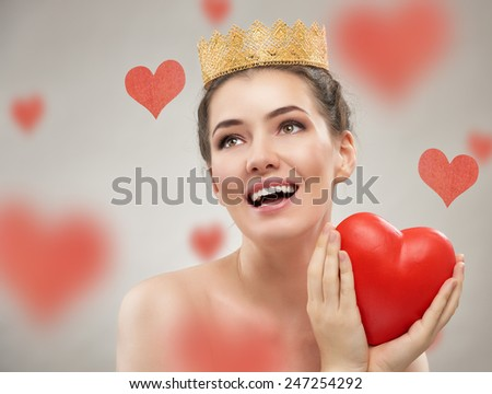 beautiful woman with red heart - stock photo