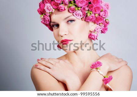 Beautiful woman with rose flowers in hair - stock photo