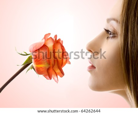 beautiful woman with rose sideview - stock photo