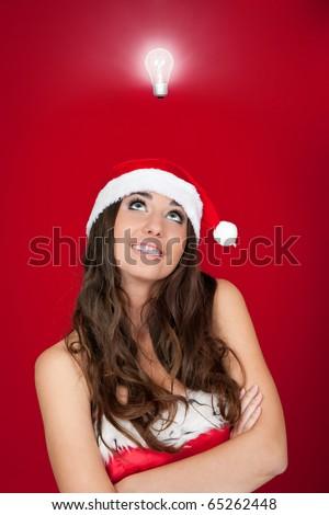 beautiful woman with santa hat got an idea - stock photo