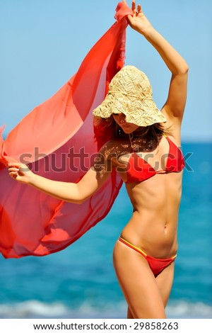 beautiful woman with scarf on the beach