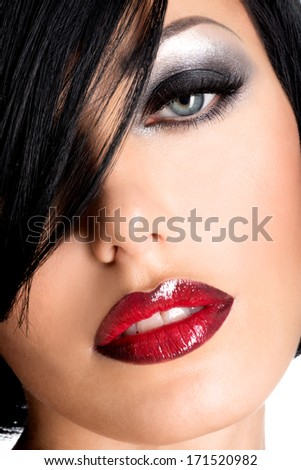 Beautiful woman with  sexy red lips and glamor eye makeup. Closeup portrait of a female model. - stock photo
