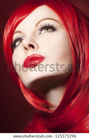 Beautiful woman with shiny red hair - stock photo