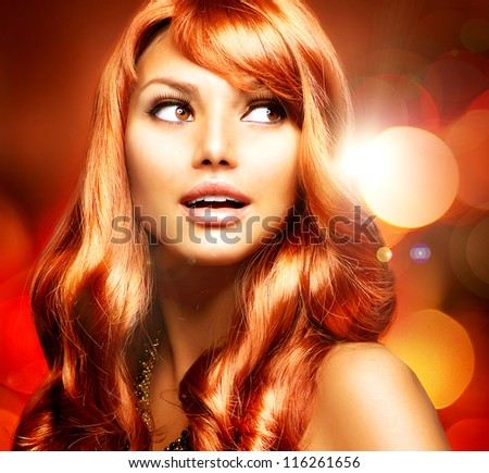 Beautiful Woman With Shiny Red Long Hair over Blinking Holiday Background.Surprised Girl - stock photo
