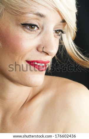Beautiful woman with short white hair on black background