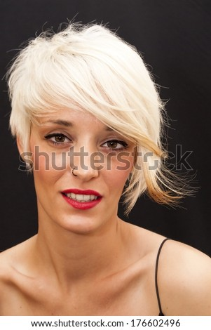 Beautiful woman with short white hair on black background - stock photo