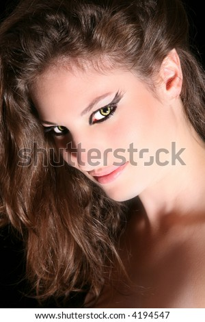 Beautiful woman with slightly pointed ears and wolverine eyes - stock photo