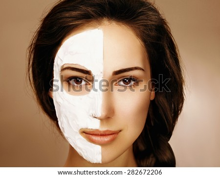 Beautiful woman with spa facial mask. In studio - stock photo
