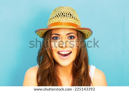 beautiful woman with straw hat smiling and happy . blue background . - stock photo