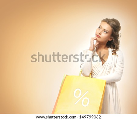 Beautiful woman with the bright shopping bags  - stock photo