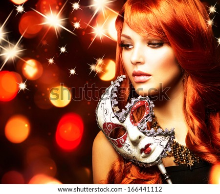 Beautiful Woman with the Carnival mask. Holiday Fashion Girl Portrait. Beauty Hairstyle and Makeup. Make up. Celebrating Glamorous Lady over Glowing Background - stock photo