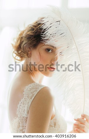 beautiful woman with the feather - stock photo