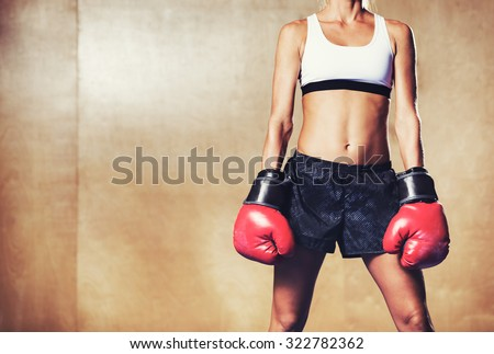 Beautiful Woman with the Red Boxing Gloves. Attractive Female Boxer. - stock photo