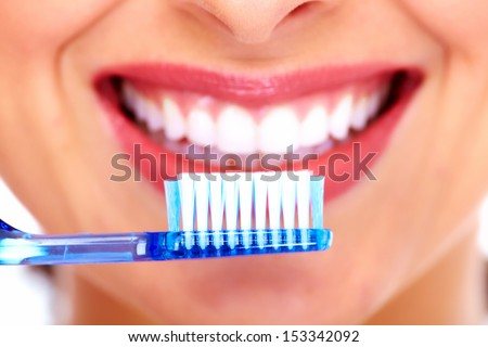 Beautiful woman with toothbrush. Dental care background. - stock photo