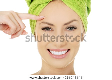 Beautiful woman with towel wrapped on head. - stock photo