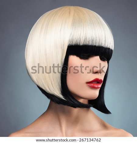 Beautiful woman with unusual bob hairstyle.Red lips model. Sexy girl - stock photo
