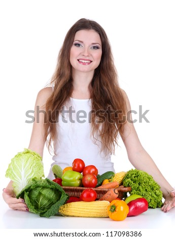 Beautiful woman with vegetables on table isolated on white