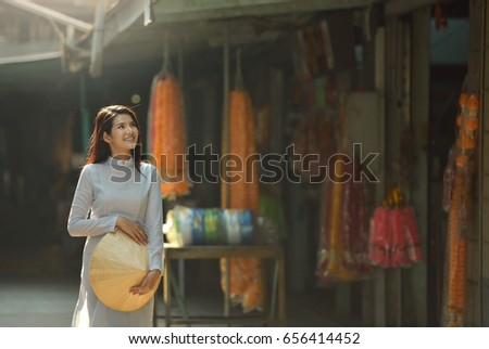 Beautiful  woman with Vietnam culture traditional dress,Ao dai is famous traditional costume ,vintage style,Vietnam