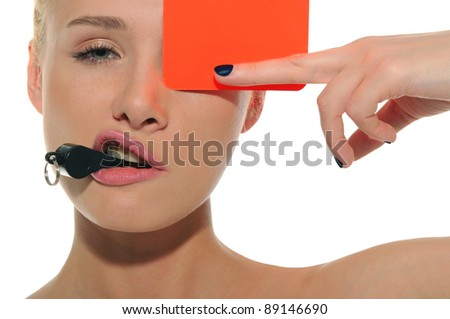 beautiful woman with whistle and red card isolated on white - stock photo