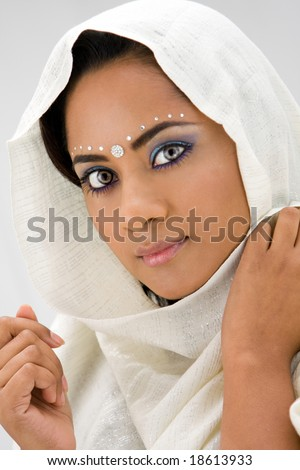 Beautiful woman with white head scarf, isolated - stock photo