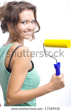 beautiful woman with yellow roll - stock photo
