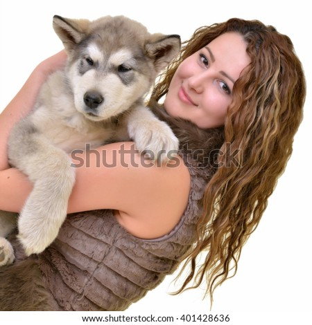 Beautiful woman with young dog Malamute