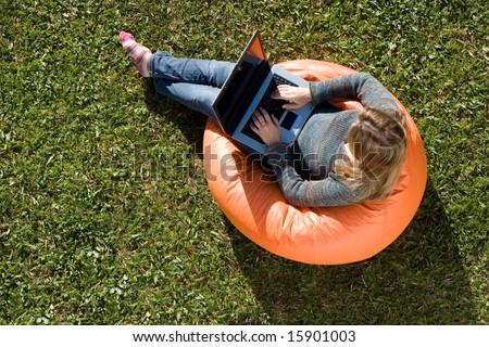 beautiful woman working out sitting on orange puff - stock photo