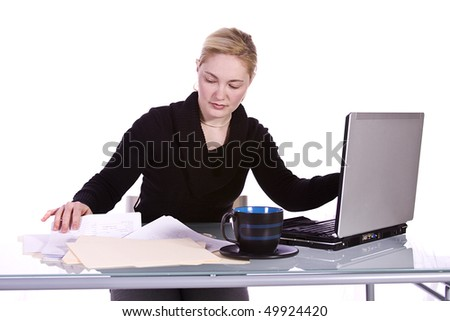 Beautiful Woman Working with Books and Laptop on her Desk