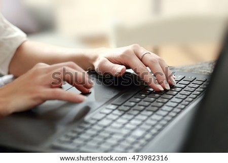 beautiful womans hands on the keyboard typing the text