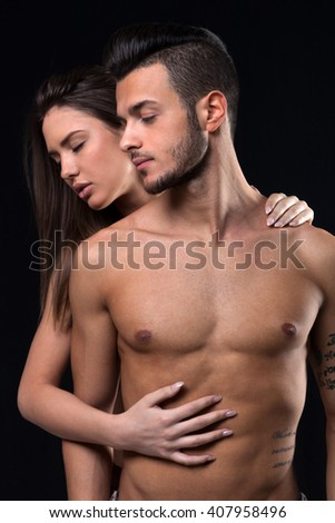 Beautiful women and handsome man against black background - stock photo